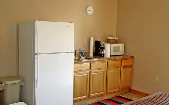 Convenience comes in our kitchen with refrigerator, coffee pot, washing machine and dryer