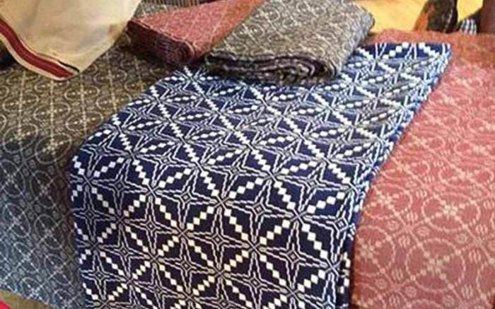 Coverlets displayed on an Antique Bed