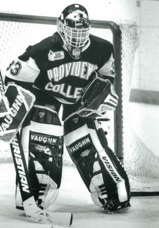 Sara DeCosta in Providence College uniform protecting goal