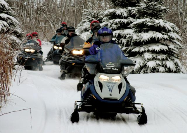 Snowmobilers at Seven Springs Snow Mobile Tours in Laurel Highlands