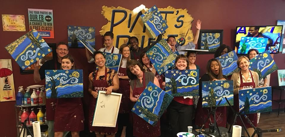 People Holding Up Their Artwork at Pinot's Pallete