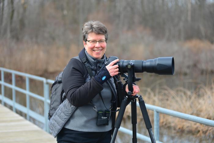 Jan Lewisat Reeds Lake looking for birds