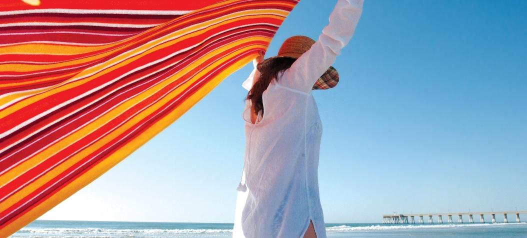 Woman on Wrightsville Beach with a colorful towel