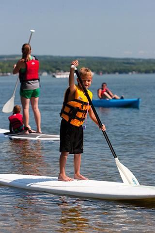 Young boy paddleboarding