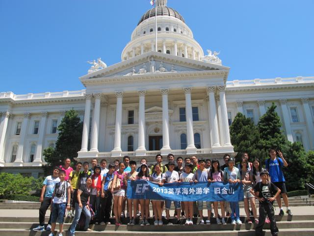 Student pose in front of the California State Capitol building.
