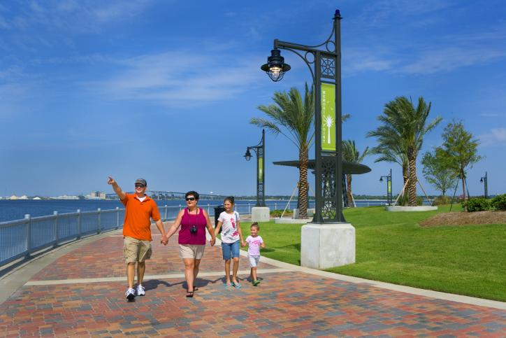 Family Walking on Lakefront Promenade
