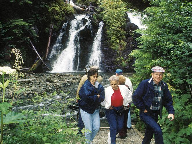 Walk to the waterfall after your meal at the Gold Creek Salmon Bake.