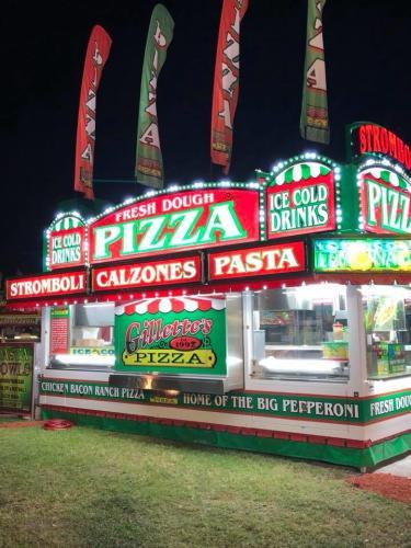 Saratoga Co. Fair pizza vendor lit up at night