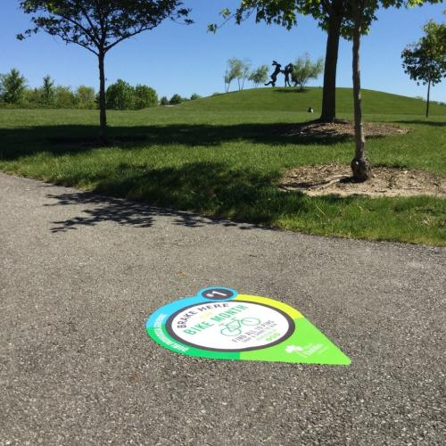 Street decal pin pointing best bike paths in Dublin, Ohio.
