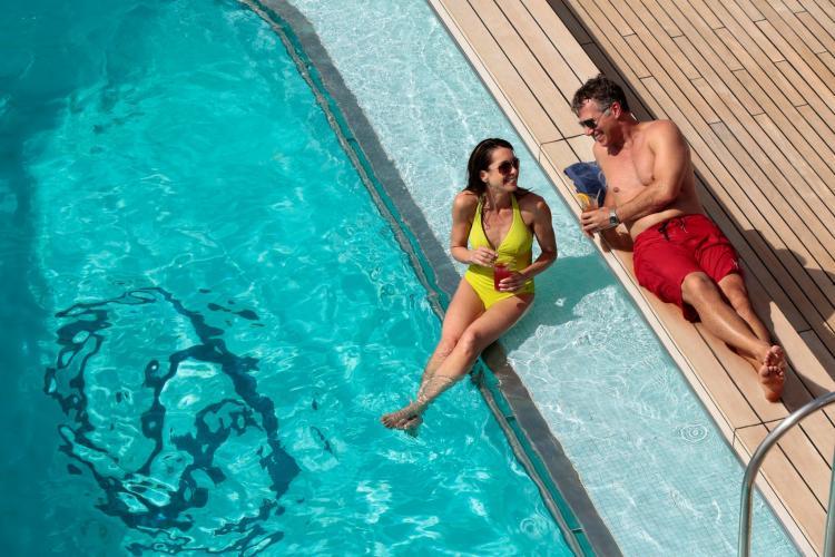 Couple enjoying the sun at pool