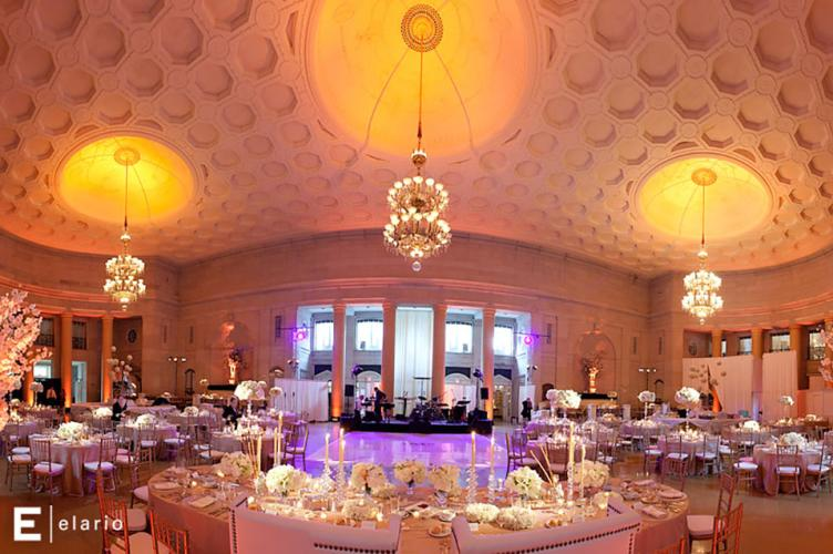 Hall of Springs Imagine your wedding at Saratoga National, a unique jewel in this city renowned for stunning architecture and world-famous horse racing. Welcomed by an over-sized foyer elegantly appointed with rich woodwork. Outside, guests can relax on the covered veranda and patio terrace amid fire pits and an infinity pool. For local couples, or brides and grooms from out of town looking for a unique destination, Saratoga National is the perfect place to exchange vows and create memories. Saratoga National has earned a reputation for creative cuisine and impeccable service working in collaboration with Mazzone Hospitality, the region's leading, award-winning caterer. The Hall of Springs is a historical, world renowned venue in Saratoga Springs, NY. Located on the Saratoga Performing Arts Center grounds. Our award-winning service is first and foremost and attention to detail is second to none. When it comes to tying the knot, we make it our mission to understand your vision and are excited to bring your wedding dreams to life. Whether hosting a wedding reception or the entire ceremony, our beautifully adorned ballroom can accommodate your every wish. Our wedding packages are some of the most magnificent in the Capital Region and can be customized for every budget.