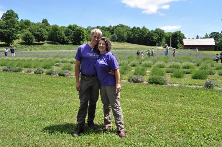 Dave and Diane Allen standing in front of lavender fields at Lavenlair Farm