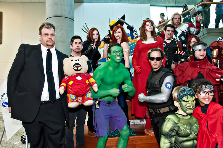 Large group of superhero cosplayers featuring the Hulk, wolverine, and others