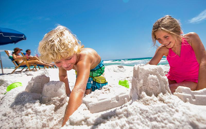 Kids building sand castle