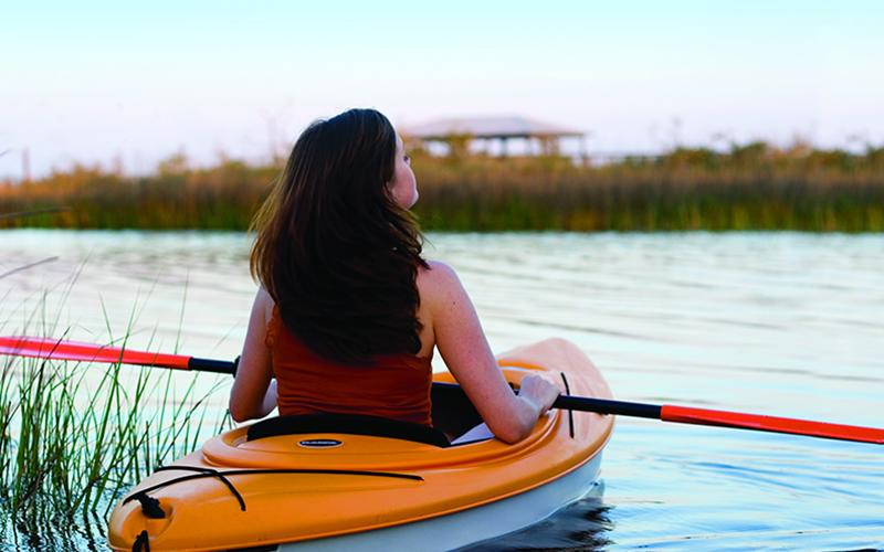 Woman kayaking on Perdido Bay