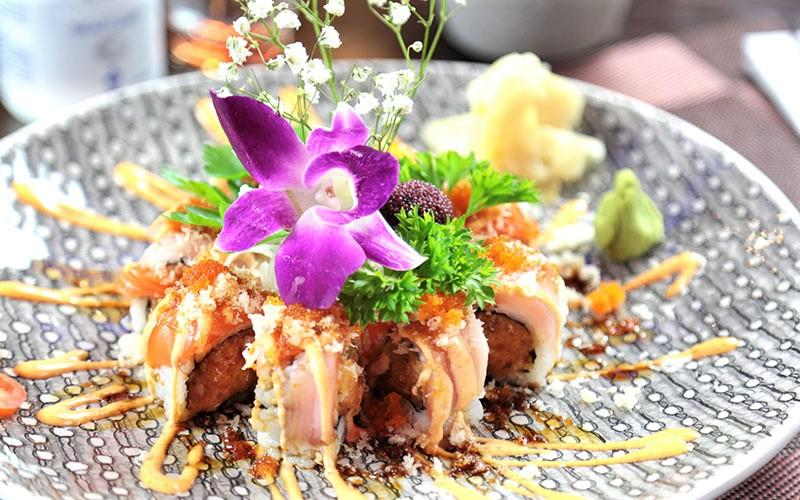 Plate of sushi with floral decoration from Wasabi Restaurant in Saratoga Springs, NY