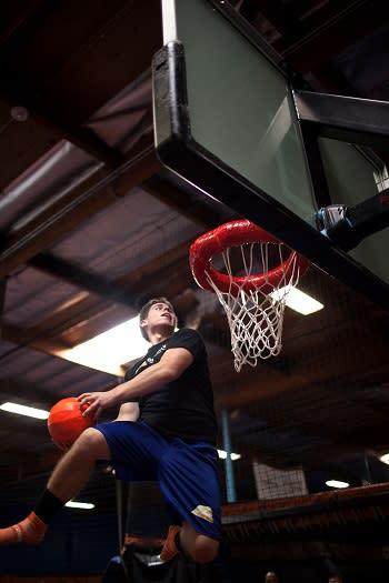Sky Zone dunking basketball