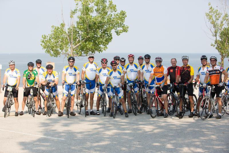Gran Fondo cyclists posing for a photo in Grand Rapids