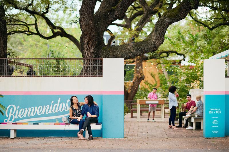 Couple sitting outside of the Fresas patio in Austin Texas