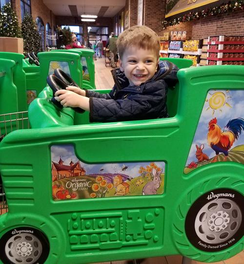 Hudson driving Wegmans green car in Canandaigua