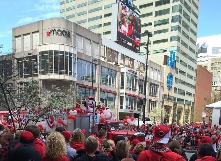 Cincinnati Reds fans watching Rosie Red on a parade float in downtown Cincinnati