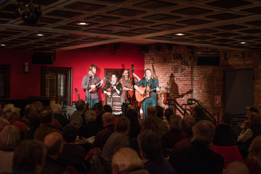 Folk band playing to crowd at Caffe Lena in Saratoga
