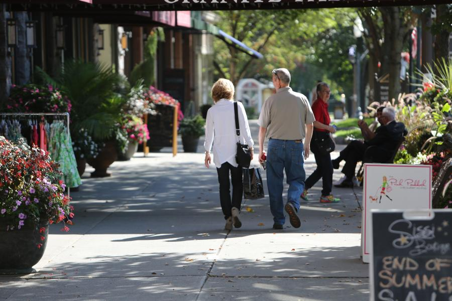 couple strolling around on broadway