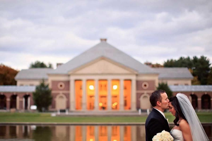 Groom kissing bride's forehead in saratoga spa state park
