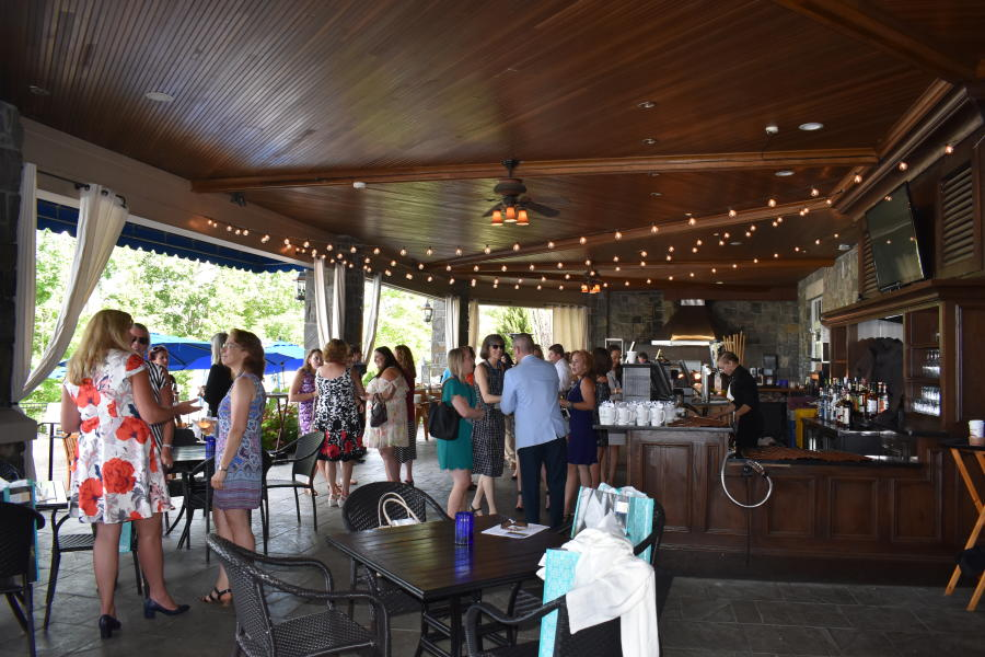 Group networking at the Saratoga National Golf Club patio