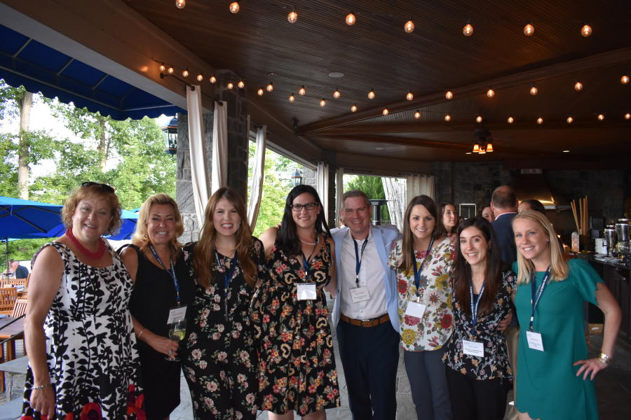 Medium sized group smiling at Saratoga National Golf Club networking event