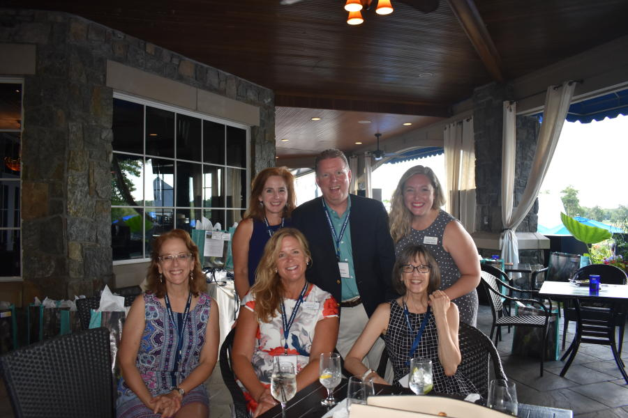 Small group smiling for camera at Saratoga National networking event