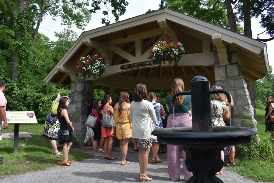Group circled around High Rock Spring in Saratoga during tour