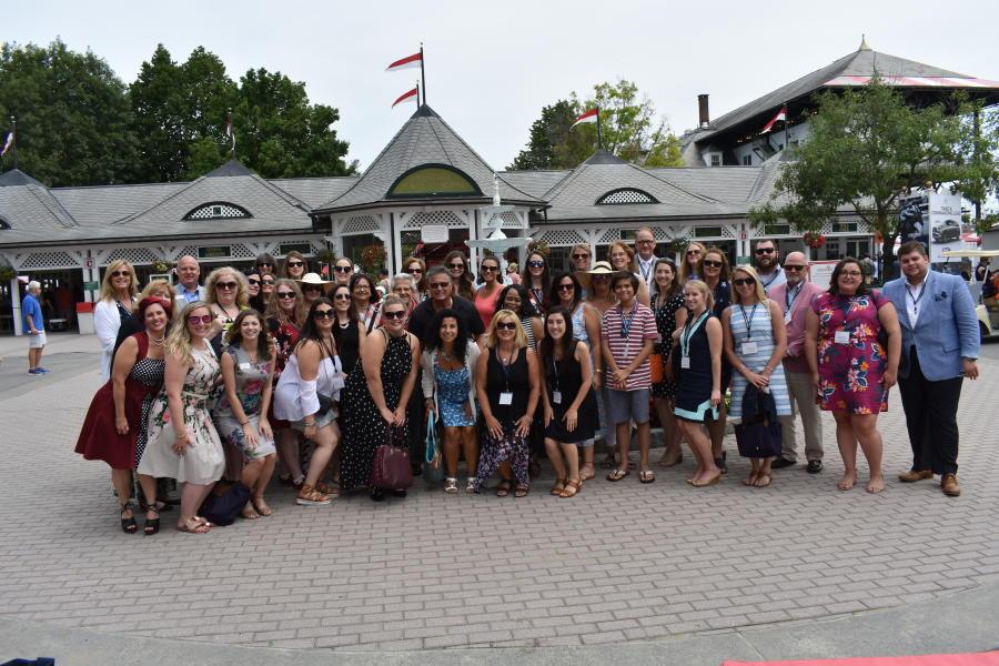 Group standing outside Saratoga Race Course entrance