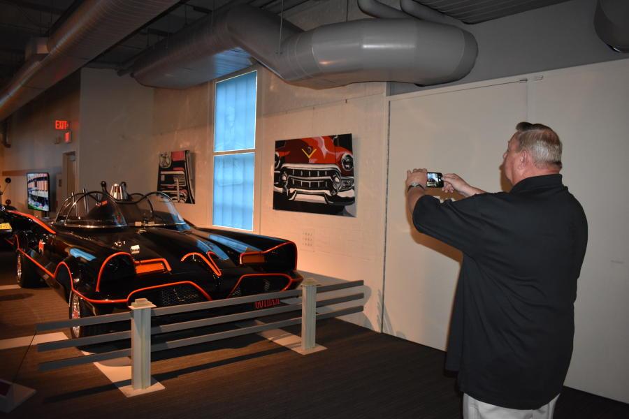 Man taking photo of 1966 Batmobile Replica at Saratoga Automobile Museum