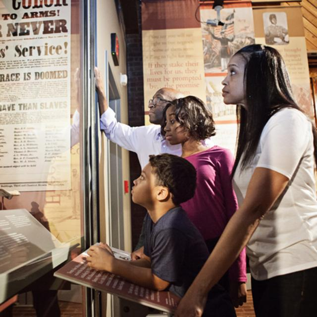 Family in the exhibit at Historic Tredegar