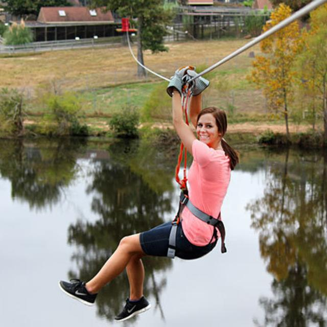 Riding the Zip line over the lake