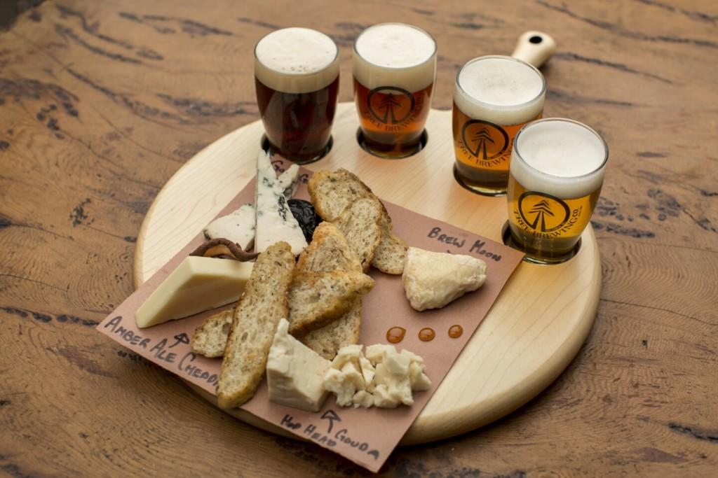 A cheese and beer flight at The Beer Institute in downtown Kelowna is one great way to learn about our local craft beer. Photo courtesy of Tree Brewing and Tourism Kelowna