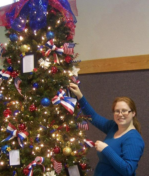 Christmas in the Park - Desirea Wysong decorating the Tree for Veterans