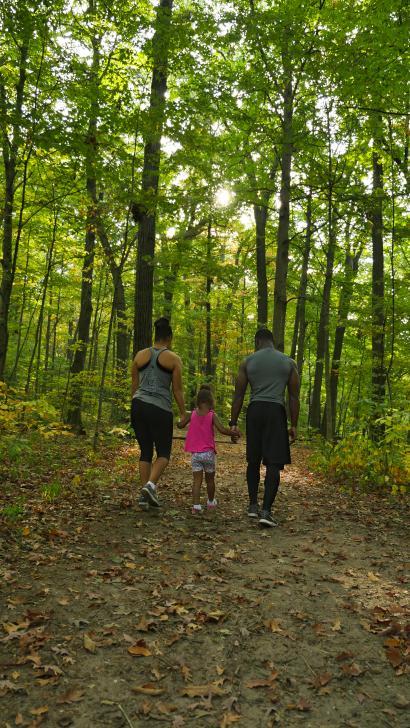 Family hiking at Aman Park