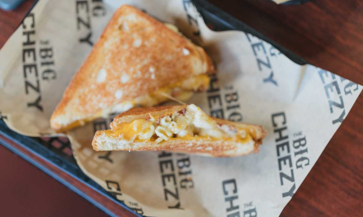 The Big Cheezy - Mac N' Cheesy Grilled Cheese, Waffle Fries, Parm Bird Grilled Cheese