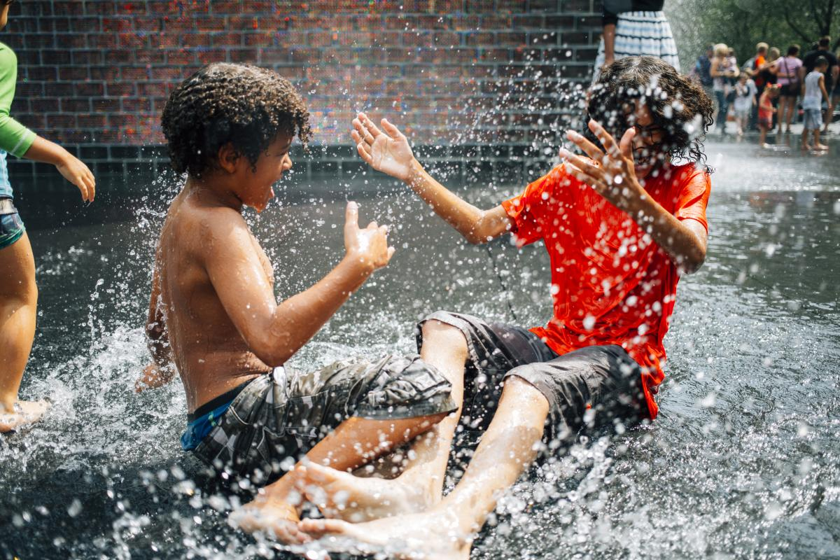 Kids playing in Crown Fountain in Millennium Park, Chicago