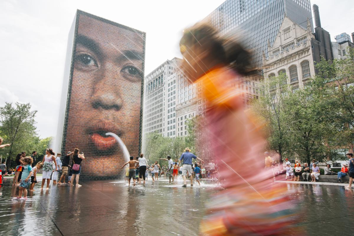 Children playing in Chicago's Crown Fountain in Millennium Park