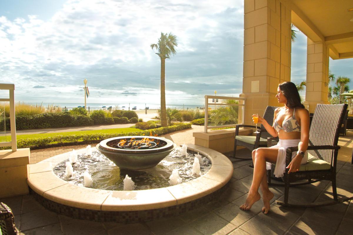 resort ultra craft cocktails sun deck oceanfront beach tiki bar fire pit lounge