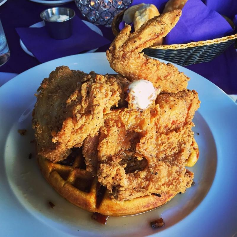 a blue plate heaped with fried chicken at the purple poulet bourbon bistro