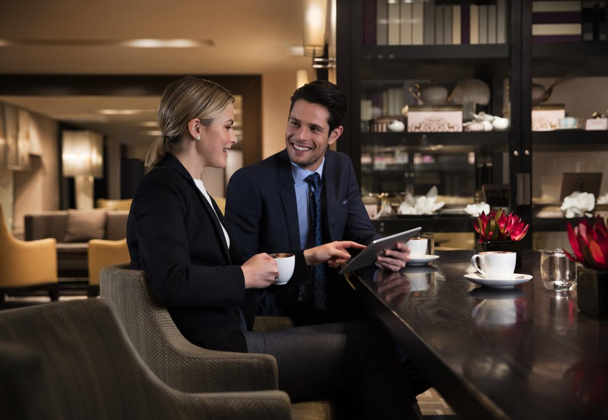 Two people having a business meeting over coffee at Grand Hyatt Melbourne