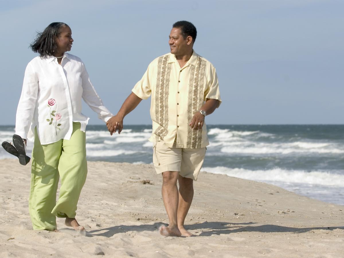 Couple walking along the beach