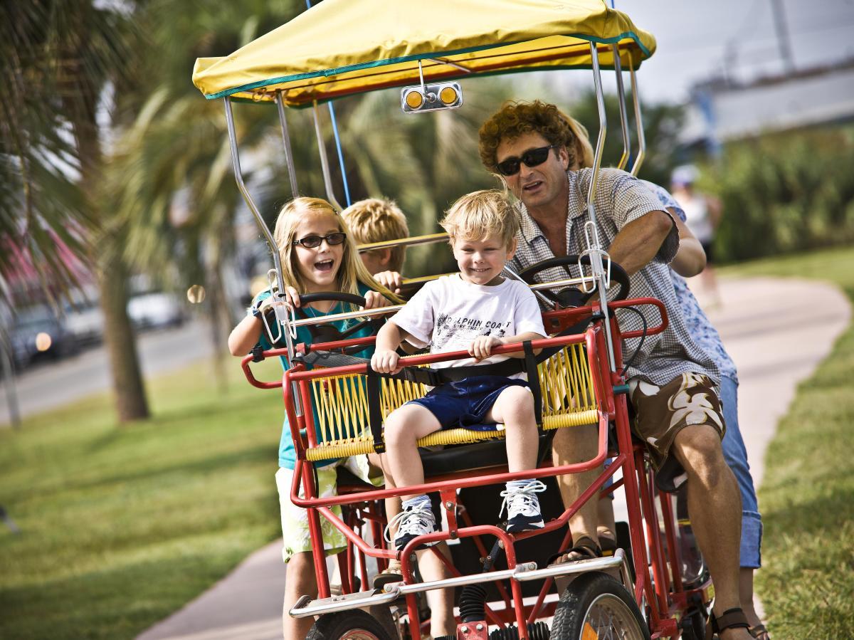 Family on Surrey Bike at Carolina Beach Lake Park
