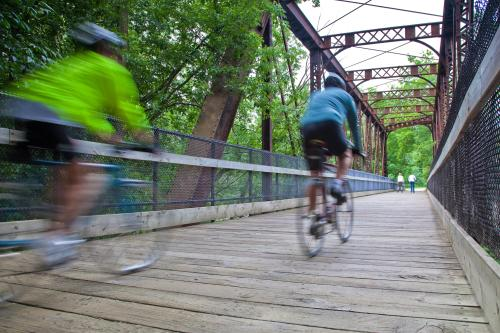 Biking across bridge in Grand Rapids