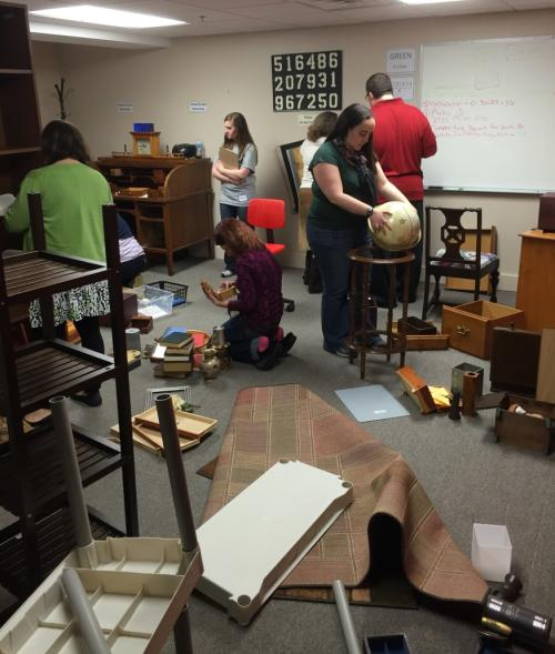 Group solving The Great Escape Room puzzle room in Grand Rapids