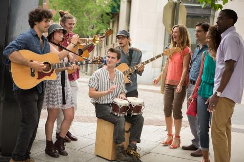 Buskers line the streets of downtown to perform for the crowd.